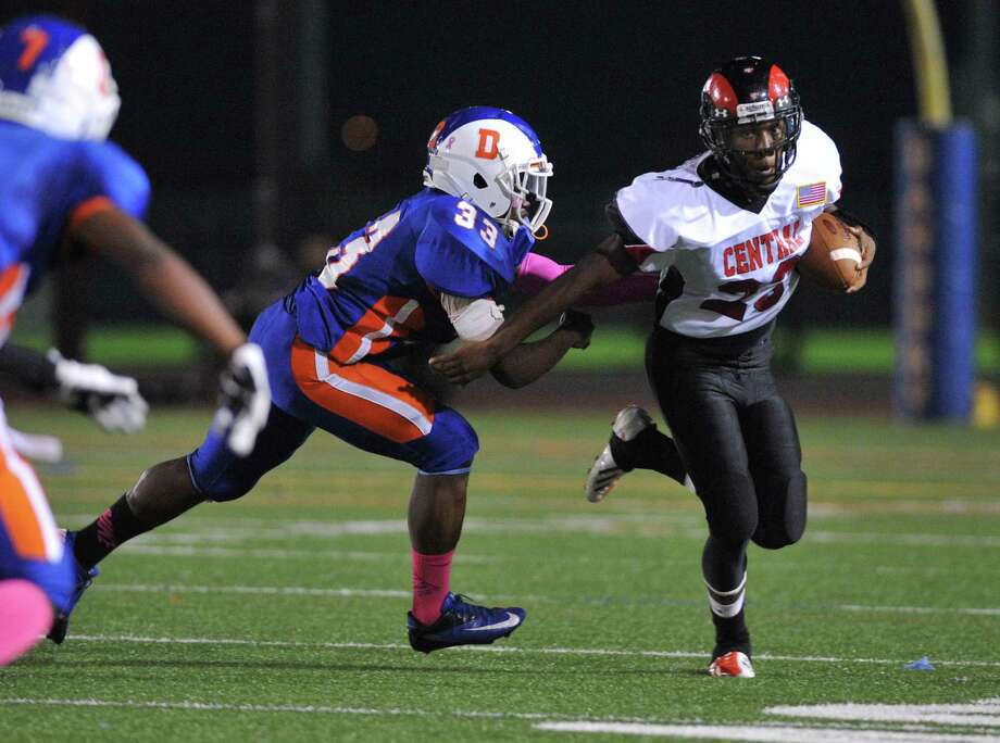 Bridgeport Central's Mykel Morris, right, avoids Danbury defender Gregory Ashe in the FCIAC high school football game between Danbury and Bridgeport Central at Danbury High School in Danbury, Conn. on Friday, Oct. 4, 2013. Photo: Tyler Sizemore / The News-Times