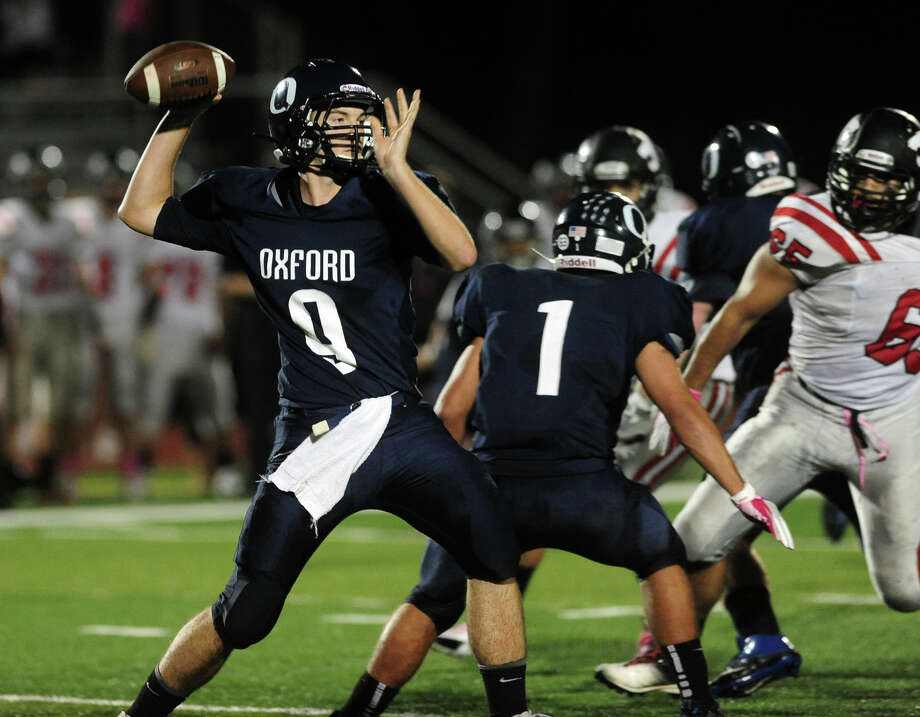 Oxford QB Kyle Chudoba, during high school football action against Masuk in Oxford, Conn. on Friday October 4, 2013. Photo: Christian Abraham / Connecticut Post