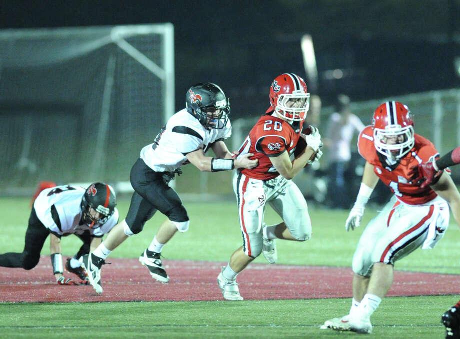 High School football game between New Canaan High School and Fairfield Warde High School at New Canaan, Friday night, Oct. 4, 2013. Photo: Bob Luckey / Greenwich Time