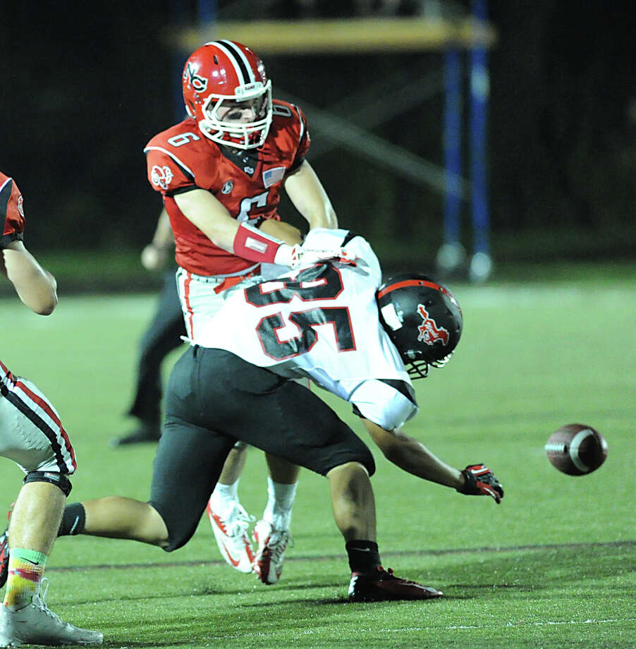 At left, Teddy Bossidy (# 6) of New Canaan breaks up a pass play to Fairfield Warde's Andrew Girard (# 85) during the high School football game between New Canaan High School and Fairfield Warde High School at New Canaan, Friday night, Oct. 4, 2013. Photo: Bob Luckey / Greenwich Time