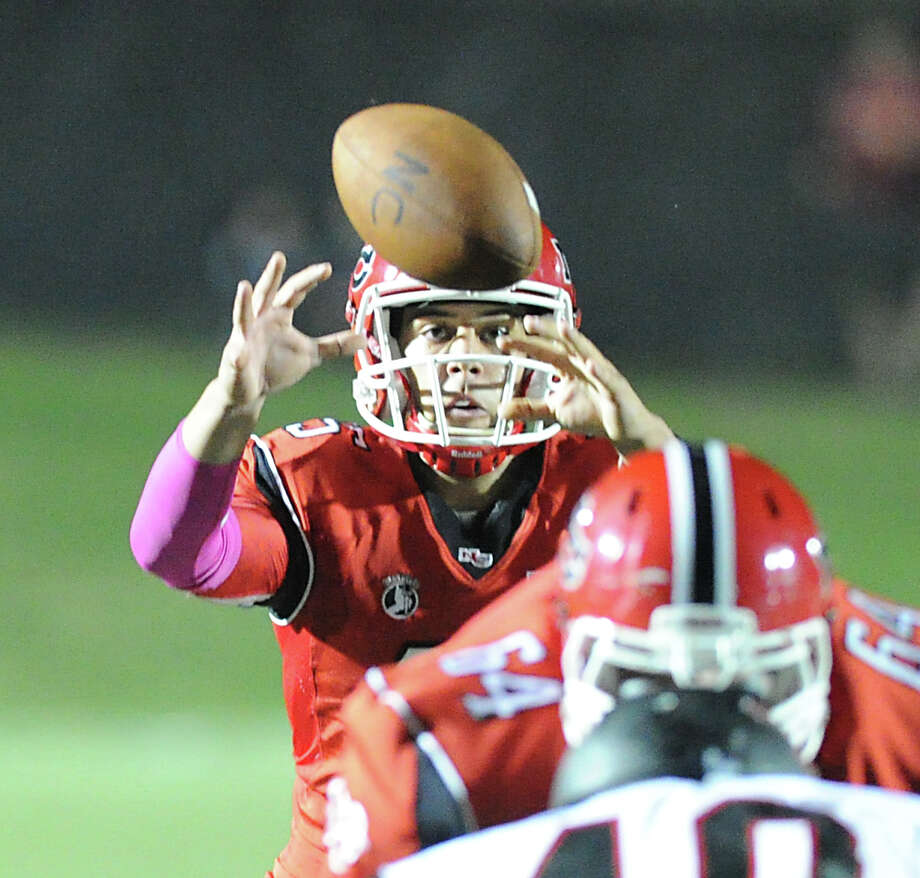 New Canaan quarterback Nick Cascione (# 15) during the second quarter of the high School football game between New Canaan High School and Fairfield Warde High School at New Canaan, Friday night, Oct. 4, 2013. Photo: Bob Luckey / Greenwich Time