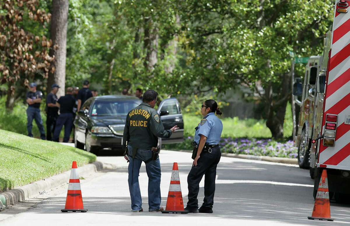 Law enforcement officials conduct a search of a home on Fall River Road in the Memorial area on Friday. It was the second residence in Houston that was raided by federal agents.
