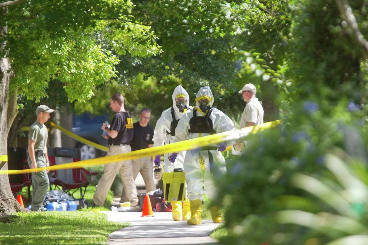 Agents with an FBI hazardous materials response team search a home Friday morning on Albans near Rice Village.