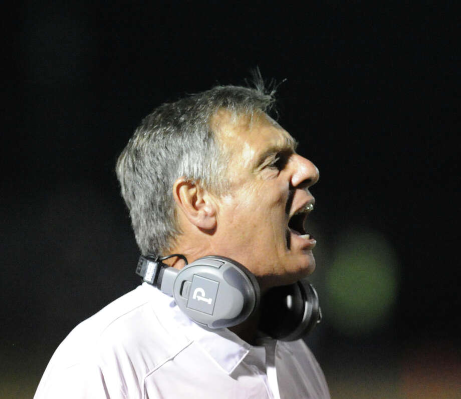 New Canaan football coach Lou Marinelli during the High School football game between New Canaan High School and Fairfield Warde High School at New Canaan, Friday night, Oct. 4, 2013. Photo: Bob Luckey / Greenwich Time