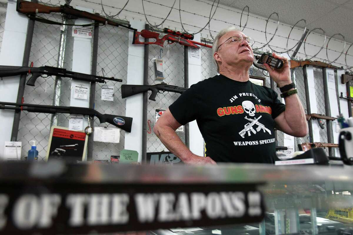 Jim Pruett, owner of Jim Pruett's Gun's & Ammo store, calls out an order to allocate and restock his store on Wednesday, Oct. 2, 2013, in Houston. Gun stores need to provide the federal form to customers in order to formally request permission to purchase the weapon. Texas has more than 1 million people who have filled out form.