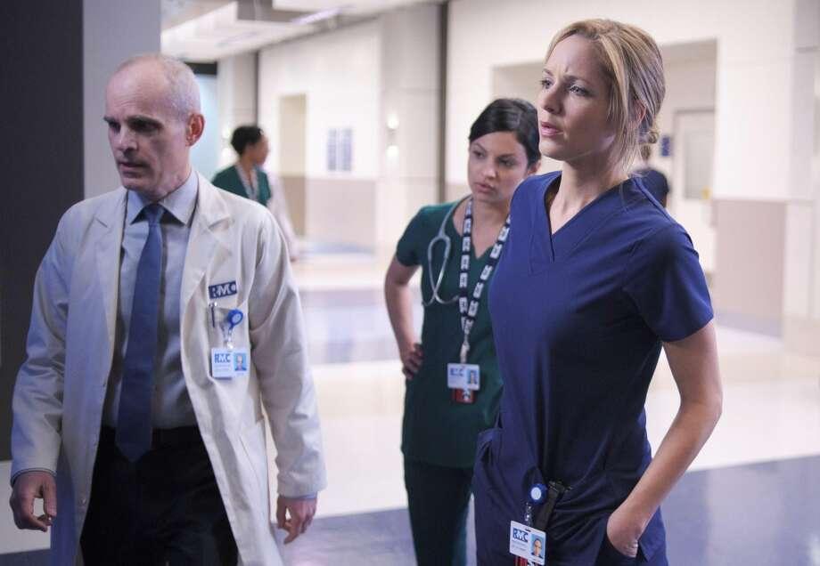"Zeljko Ivanek, Floriana Lima and Jordana Spiro in a scene from ""The Mob Doctor"""