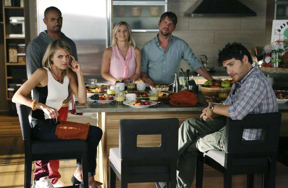 This image released by ABC shows cast members, clockwise from foreground left, Eliza Coupe, Damon Wayans Jr., Elisha Cuthbert, Zachary Knighton and Adam Pally