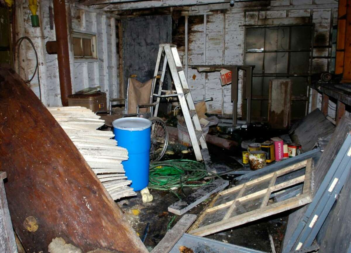 Inside the small storage house behind Scofield Manor where unsealed pesticide was discovered and was sealed inside the blue barrel pictured at left, Tuesday, Jan. 25th, 2010.