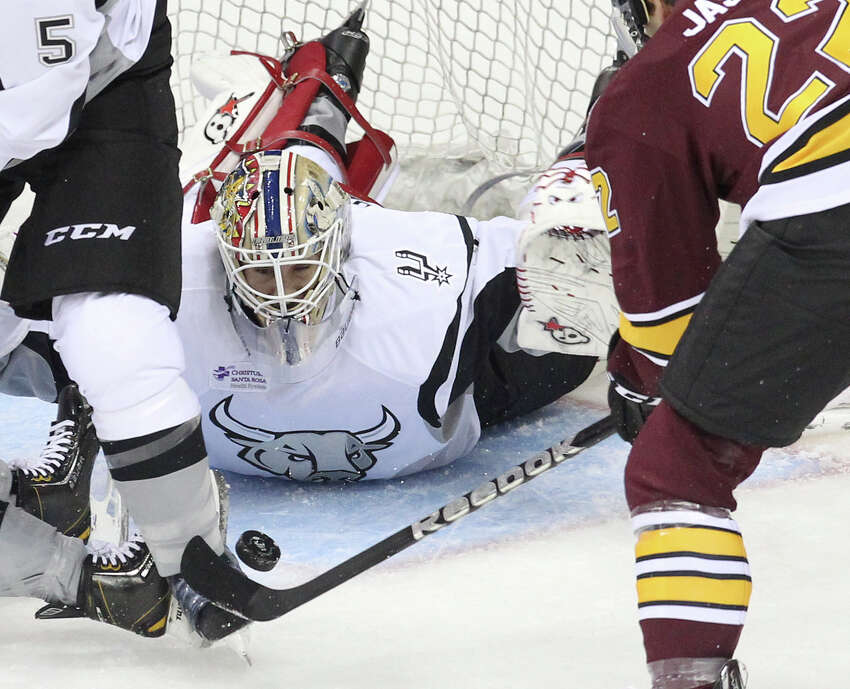 Rampage goalie Dov Grumet-Morris (01) stares down the puck as Chicago Wolves' Dmitrij Jaskin (22) attempts a shot during the Rampage's home opener on Friday, Oct. 4, 2013.