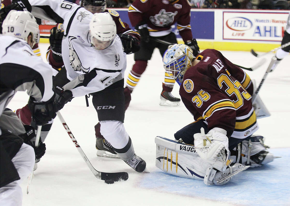 Rampage's Garrett Wilson (19) attempts to score against Chicago Wolves goalie Jake Allen (35) Pat Cannone (21) during the Rampage's home opener on Friday, Oct. 4, 2013.