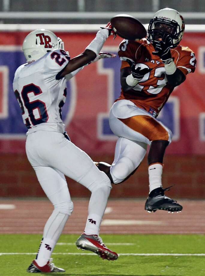 Madison's Ja'Michael Brown goes up for a pass as he is defended by Roosevelt's Will Porter during first half action Friday Oct. 4, 2013 at Heroes Stadium. The pass was incomplete. Photo: Edward A. Ornelas, Edward A. Orneles / San Antonio Express-News / © 2012 San Antonio Express-News