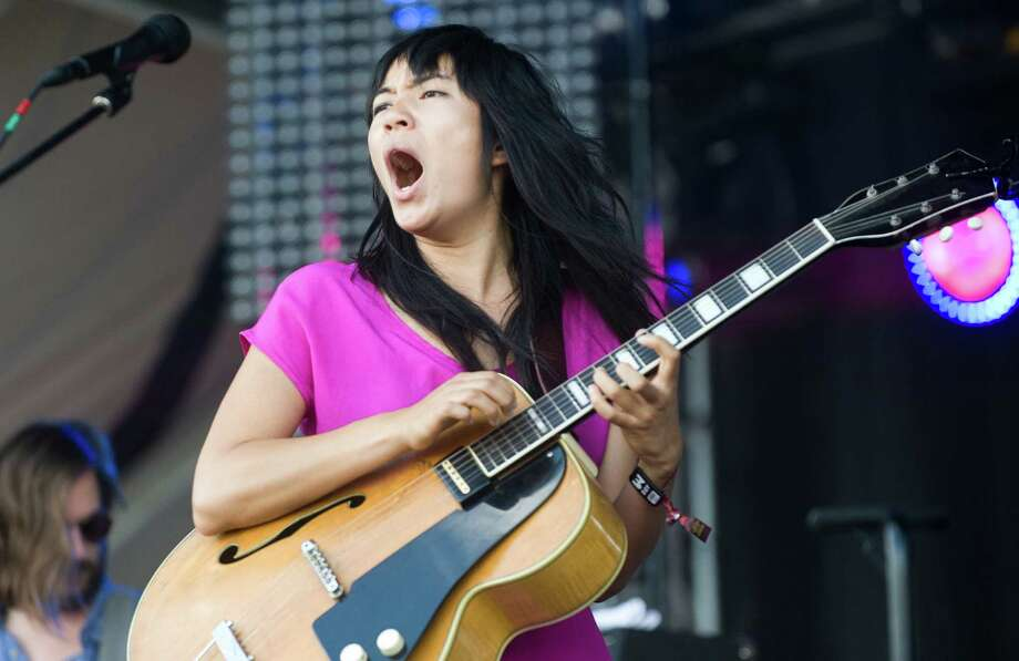 Thao Nguyen of Thao & The Get Down Stay Down performs on the first day of the Austin City Limits festival in Austin, Texas, on Friday Oct. 4, 2013. Photo: Erika Rich, Associated Press / Austin American-Statesman