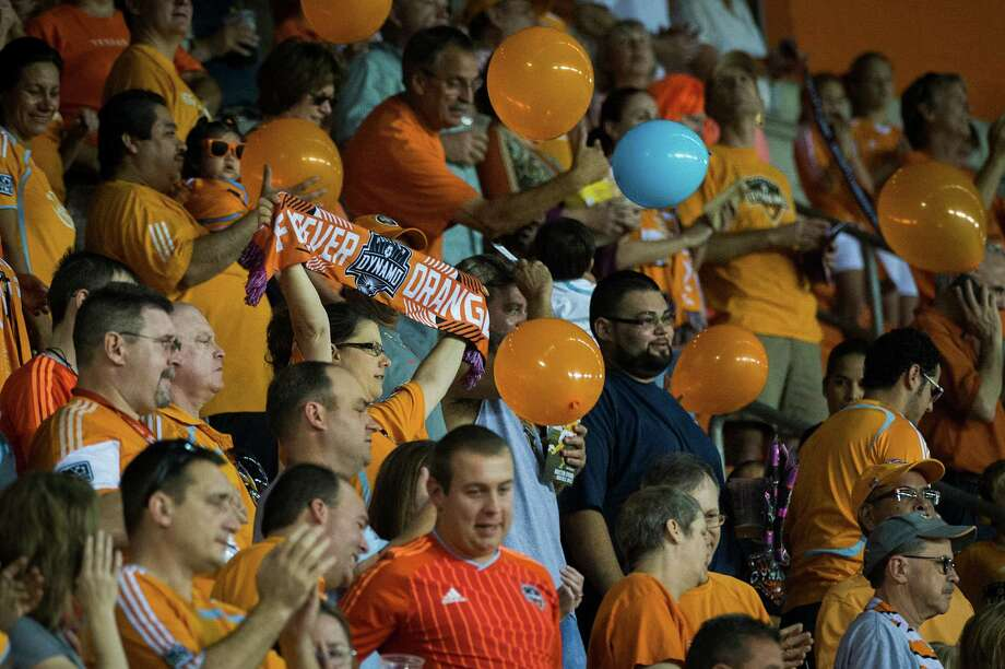 Houston Dynamo fans cheer their team before an MLS soccer match against the Montreal Impact on Friday, Oct. 4, 2013, at BBVA Compass Stadium in Houston. Photo: Smiley N. Pool, Houston Chronicle / © 2013  Houston Chronicle