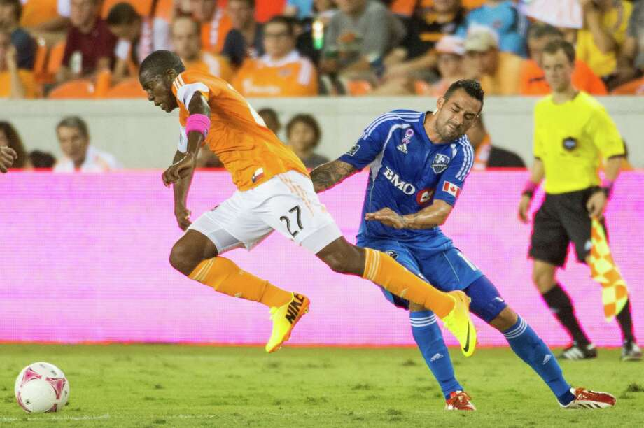 Houston Dynamo midfielder Boniek Garcia (27) gets past Montreal Impact midfielder Andres Romero during the first half of an MLS soccer match on Friday, Oct. 4, 2013, at BBVA Compass Stadium in Houston. Photo: Smiley N. Pool, Houston Chronicle / © 2013  Houston Chronicle