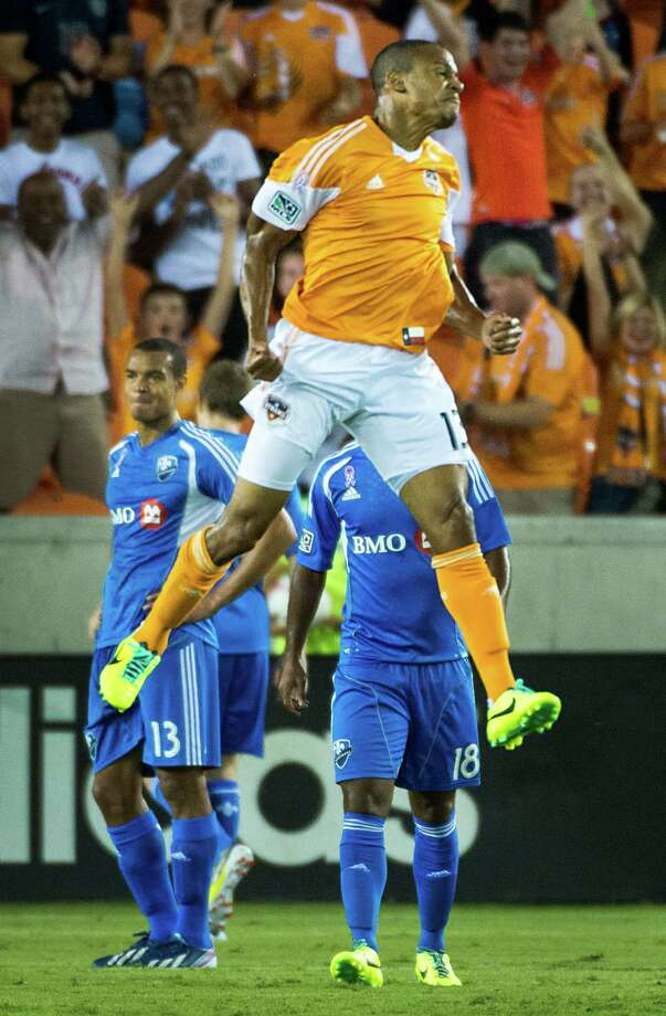 Houston Dynamo midfielder Ricardo Clark celebrates after scoring a goal during the first half of an MLS soccer match against the Montreal Impact on Friday, Oct. 4, 2013, at BBVA Compass Stadium in Houston. Photo: Smiley N. Pool, Houston Chronicle / © 2013  Houston Chronicle