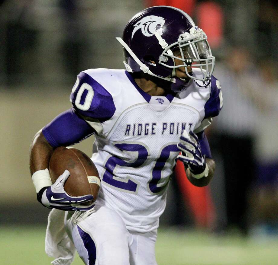 Ridge Point's KeShawn Ledet runs with the ball against Fort Bend Marshall during a high school football game between Ridge Point and Fort Bend Marshall Friday October 4, 2013. (Bob Levey/For The Chronicle) Photo: Bob Levey, Houston Chronicle / ©2013 Bob Levey