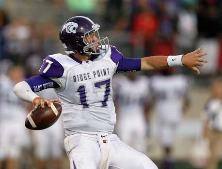 Ridge Point 24, Fort Bend Marshall 21 Ridge Point quarterback Jesse Crebbe looks for a receiver against Fort Bend Marshall during a high school football game between Ridge Point and Fort Bend Marshall Friday October 4, 2013. (Bob Levey/For The Chronicle) Photo: Bob Levey, Houston Chronicle / ©2013 Bob Levey