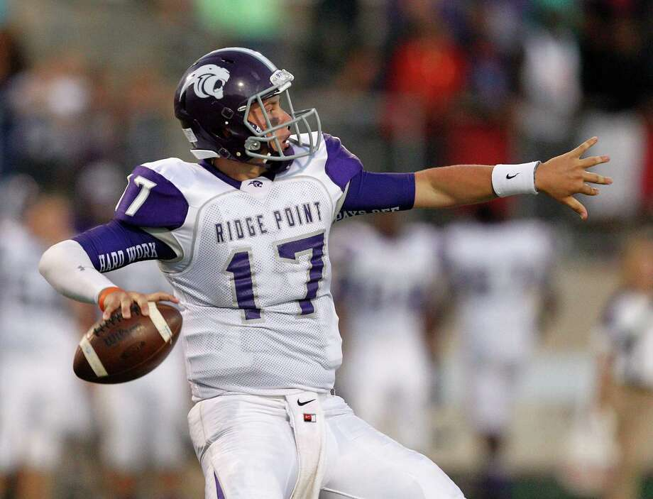 Ridge Point quarterback Jesse Crebbe looks for a receiver against Fort Bendf Marshall during a high school football game between Ridge Point and Fort Bend Marshall Friday October 4, 2013. (Bob Levey/For The Chronicle) Photo: Bob Levey, Houston Chronicle / ©2013 Bob Levey