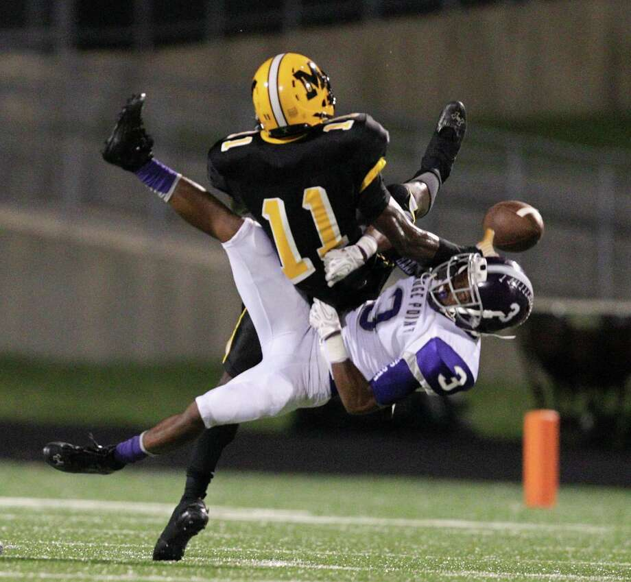 Fort Bend Marshall's Kendall Sheffield (11) breaks up a pass intended for Ridge Point's Blake Wesley (3) during a high school football game between Ridge Point and Fort Bend Marshall Friday October 4, 2013. (Bob Levey/For The Chronicle) Photo: Bob Levey, Houston Chronicle / ©2013 Bob Levey