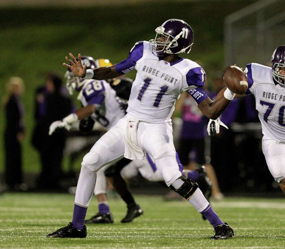 Ridge Point quarterback Troy Alexander throws downfield against  Fort Bend Marshall during a high school football game between Ridge Point and Fort Bend Marshall Friday October 4, 2013. (Bob Levey/For The Chronicle) Photo: Bob Levey, Houston Chronicle / ©2013 Bob Levey
