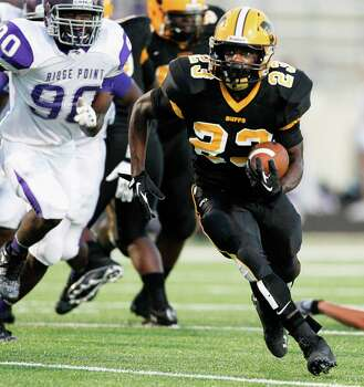 Fort Bend Marshall running back Davon Crookshank rushes against Ridge Point during a high school football game between Ridge Point and Fort Bend Marshall Friday October 4, 2013. (Bob Levey/For The Chronicle) Photo: Bob Levey, Houston Chronicle / ©2013 Bob Levey