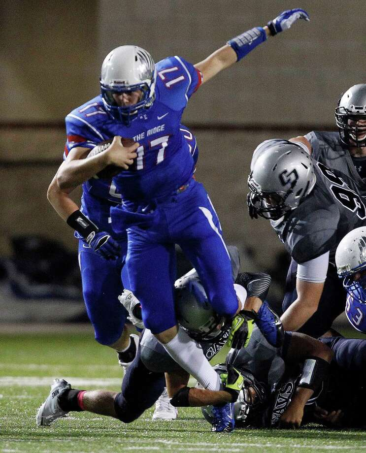 Oak Ridge's Jacob Norton (17) eludes the tackle of a College Park defender during the first half of a high school football game, Friday, October 4, 2013 at Woodforest Stadium in Shenandoah. Photo: Eric Christian Smith, For The Chronicle