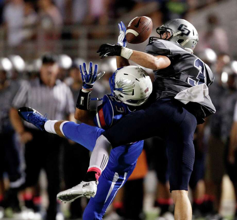 College Park's Ryder Lucas (3) breaks up a pass intended for Oak Ridge's Riley McKnight during the first half of a high school football game, Friday, October 4, 2013 at Woodforest Stadium in Shenandoah. Photo: Eric Christian Smith, For The Chronicle