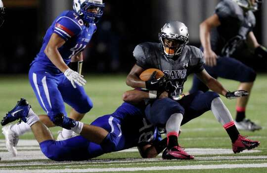 College Park's Nicholasd Black (16) is tackled by Oak Ridge's Travis Richie during the first half of a high school football game, Friday, October 4, 2013 at Woodforest Stadium in Shenandoah. Photo: Eric Christian Smith, For The Chronicle