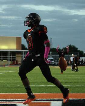 Texas City's Armanti Foreman celebrates after scoring a touchdown against Dawson during the first quarter of high school football game action at Texas City ISD's Stingaree Stadium Friday, Oct. 4, 2013, in Texas City. Photo: James Nielsen, Houston Chronicle / © 2013  Houston Chronicle
