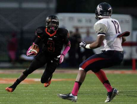 Texas City's Armanti Foreman left, and Dawson's Josiah Cooks right, during the first quarter of high school football game action at Texas City ISD's Stingaree Stadium Friday, Oct. 4, 2013, in Texas City. Photo: James Nielsen, Houston Chronicle / © 2013  Houston Chronicle
