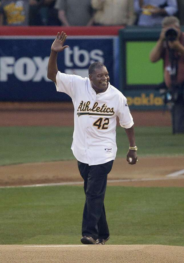 Former Oakland Athletics player Dave Henderson waves before throwing out the ceremonial first pitch before Game 1 of the American League baseball Division Series between the Oakland Athletics and the Detroit Tigers in Oakland, Calif., Friday, Oct. 4, 2013. (AP Photo/Jeff Chiu) Photo: Jeff Chiu, Associated Press