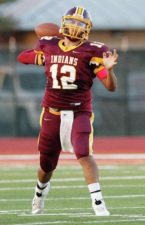 Harlandale quarterback Brandon Ramon prepares to throw a pass during the first quarter of their game with Floresville at Harlandale Memorial Stadium on Oct. 4, 2013. Photo: MARVIN PFEIFFER, Marvin Pfeiffer/ Express-News / Express-News 2013