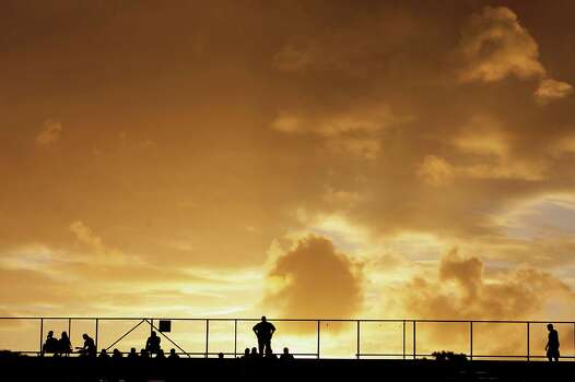 The sun set prior to Friday's high school football matchup between Texas City and Dawson at Texas City ISD's Stingaree Stadium Friday, Oct. 4, 2013, in Texas City. Photo: James Nielsen, Houston Chronicle / © 2013  Houston Chronicle