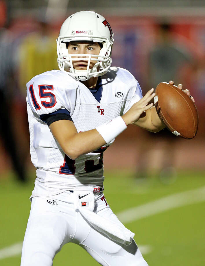Roosevelt's Jacob Preciado looks to pass against Madison during first half action Friday Oct. 4, 2013 at Heroes Stadium. Photo: Edward A. Ornelas, San Antonio Express-News / © 2012 San Antonio Express-News