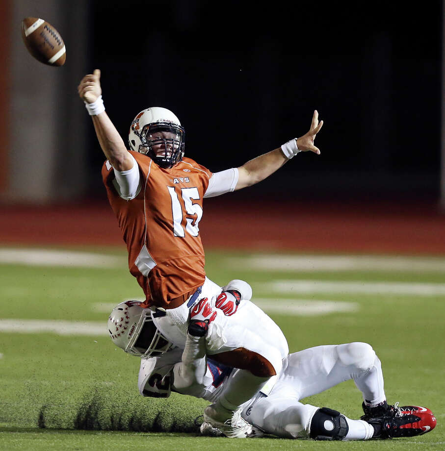 Madison's Cody Ennis passes under pressure from Roosevelt's John Taylor during first half action Friday Oct. 4, 2013 at Heroes Stadium. Photo: Edward A. Ornelas, San Antonio Express-News / © 2012 San Antonio Express-News