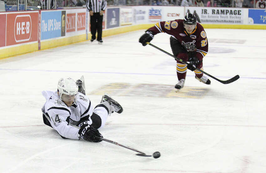 Rampage's Vincent Trocheck (14) dives to attempts a shot at the goal against Chicago Wolves' Pat Cannone (21) during the Rampage's home opener on Friday, Oct. 4, 2013.