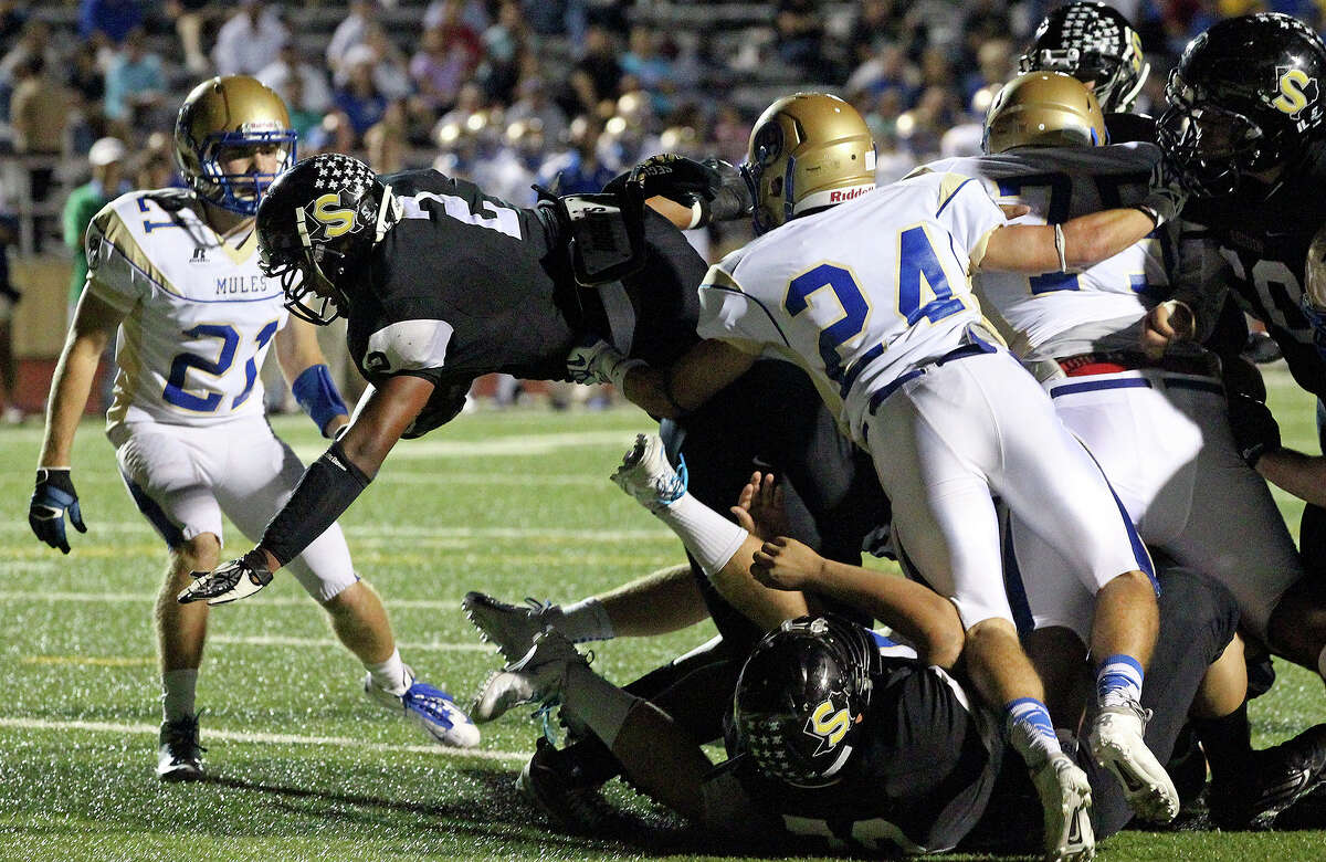 Colton Applewhite gets the ball over the goal line in the first half for the Matadors as Seguin hosts Alamo Heights at Matador Stadium on October 4, 2013.
