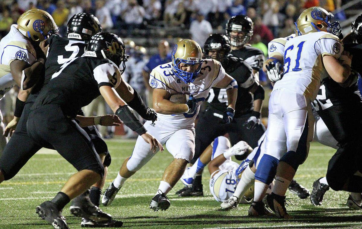 Mules running back Brandon Wasson splits a gap for a touchdown as Seguin hosts Alamo Heights at Matador Stadium on October 4, 2013.