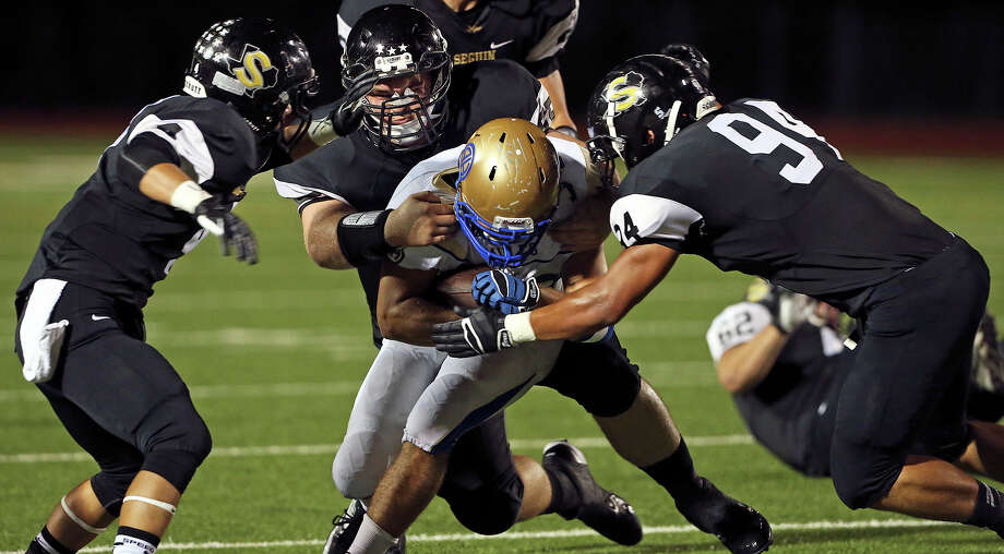The Matador defense collapses on Brandon Wasson as Seguin hosts Alamo Heights at Matador Stadium on October 4, 2013. Photo: Tom Reel, San Antonio Express-News