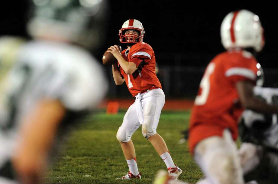 Guilderland's quarterback Frank Gallo looks to pass during their football game against Shenendehowa on Friday, Oct. 4, 2013, at Guilderland High in Guilderland, N.Y. (Cindy Schultz / Times Union) Photo: Cindy Schultz / 00024123A