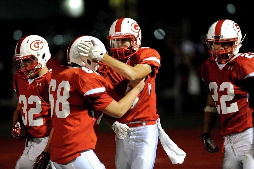 Guilderland's Jake Smith, center, celebrates a touchdown with teammates during their football game against Shenendehowa on Friday, Oct. 4, 2013, at Guilderland High in Guilderland, N.Y. (Cindy Schultz / Times Union)