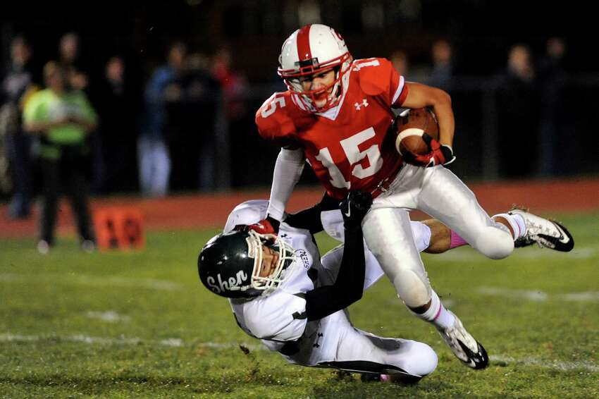 Guilderland's Joseph Cozza, right, fights for yards as Shenendehowa's Keegan Bock defends during their football game on Friday, Oct. 4, 2013, at Guilderland High in Guilderland, N.Y. (Cindy Schultz / Times Union)