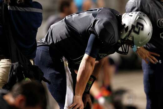 College Park quarterback Colton Farmer reacts after throwing an interception during the second half of a high school football game against Oak Ridge, Friday, October 4, 2013 at Woodforest Stadium in Shenandoah. Photo: Eric Christian Smith, For The Chronicle