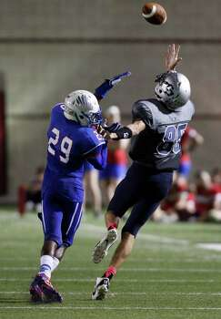College Park's Jayden Holden (85) makes a reception past Oak Ridge's Llwelldyn Jones during the second half of a high school football game, Friday, October 4, 2013 at Woodforest Stadium in Shenandoah. Photo: Eric Christian Smith, For The Chronicle