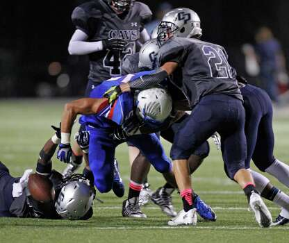 Oak Ridge's Demarcus Durst (5) fumbles after being tackled by College Park's Kyle Cole (21) during the second half of a high school football game, Friday, October 4, 2013 at Woodforest Stadium in Shenandoah. Photo: Eric Christian Smith, For The Chronicle