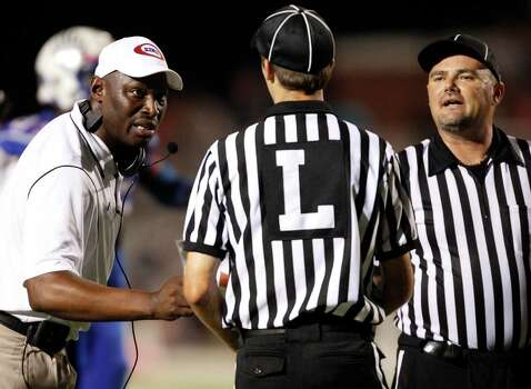 Oak Ridge head coach Dereck Rush, left, argues with an official during the second half of a high school football game against College Park, Friday, October 4, 2013 at Woodforest Stadium in Shenandoah. Photo: Eric Christian Smith, For The Chronicle