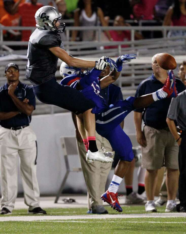 Oak Ridge's Tyler Marcel, right, breaks up a pass intended for College Park's Chance Givens during the second half of a high school football game, Friday, October 4, 2013 at Woodforest Stadium in Shenandoah. Photo: Eric Christian Smith, For The Chronicle