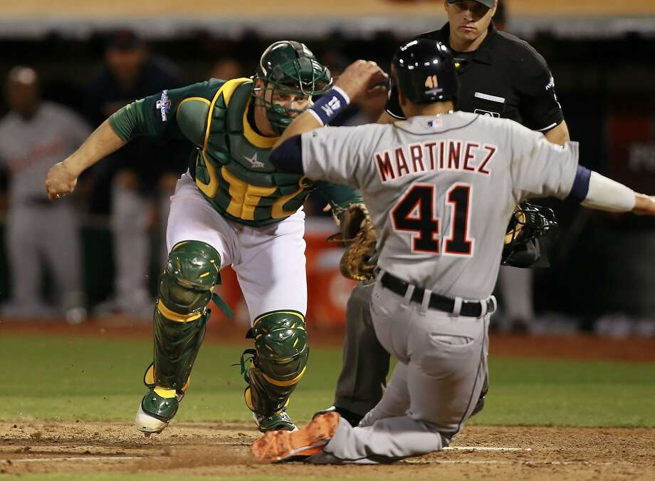 A's catcher, Stephen Vogt, (21) tags out Detroit's Victor Martinez, (41) at home in the sixth inning, on Friday Oct. 4, 2013, in Oakland, Calif. at O.co Coliseum, as the Oakland Athletics take on the Detroit Tigers in game one of the MLB American League Division Series. Photo: Michael Macor, The Chronicle