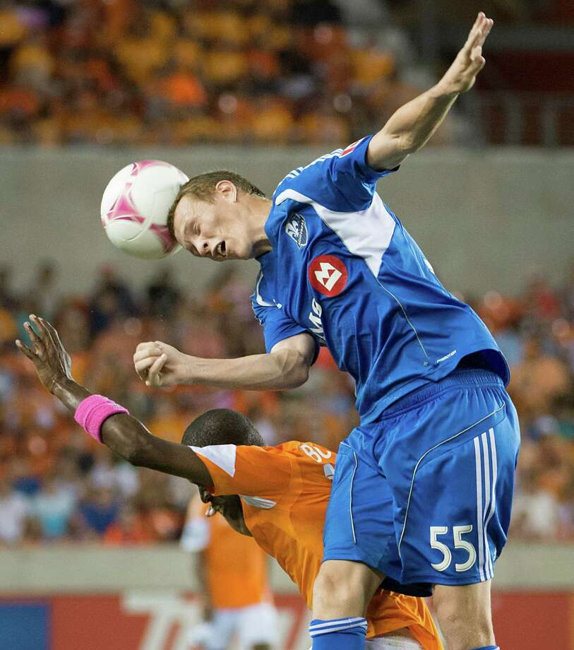 Montreal Impact midfielder Wandrille Lefevre (55) wins a header against Houston Dynamo midfielder Boniek Garcia during the second half of an MLS soccer match on Friday, Oct. 4, 2013, at BBVA Compass Stadium in Houston. Photo: Smiley N. Pool, Houston Chronicle / © 2013  Houston Chronicle