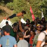 A child is seen being tossed above the crowd at the Hardly Strictly Bluegrass Festival in Golden Gate Park, in San Francisco, Ca, on Friday Oct. 4, 2013